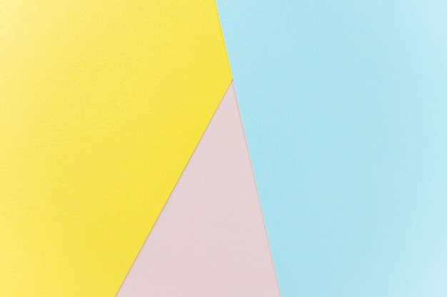 Textur papier gelb, rosa und blau.
