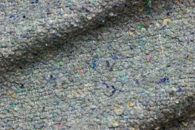 Textur und falten der decke von lappen stoff gemacht. von recyceln produkt oder globale erwärmung.