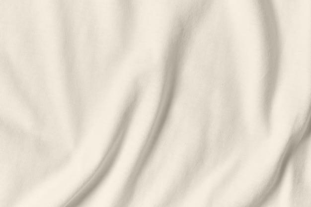 Textur und hintergrund des zerknitterten weißen stoffes.