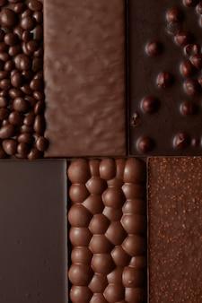 Textur verschiedener schokolade mit nüssen. lebensmittelhintergrund