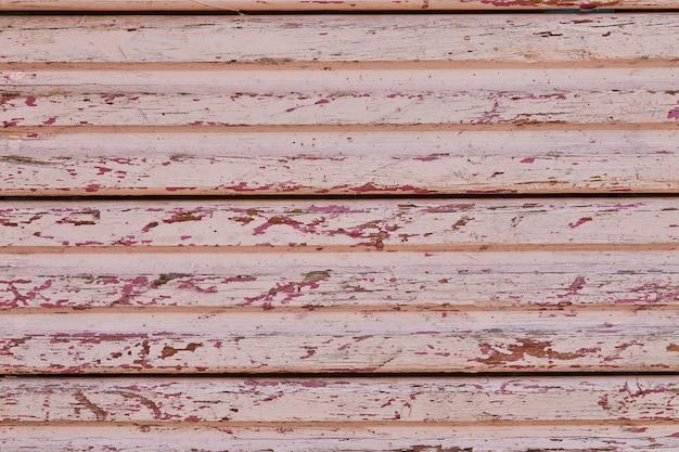 Textur von alten holzbrettern mit abblätterndem farbhintergrund.