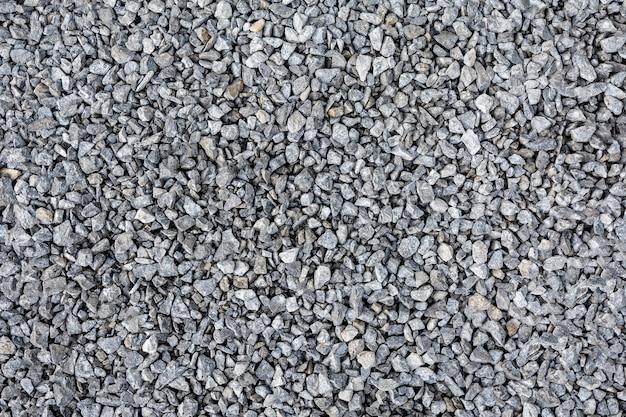 Textur von grauem bruchstein oder schutt als natürlicher hintergrund