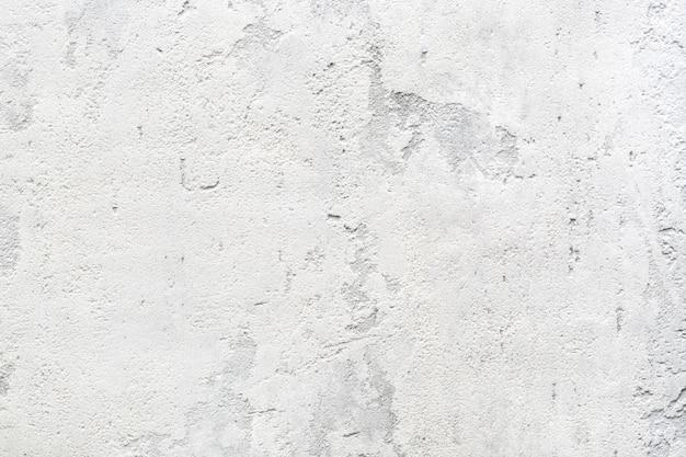 Textur von hellgrauem beton oder stuckwand abstrakter hintergrund.
