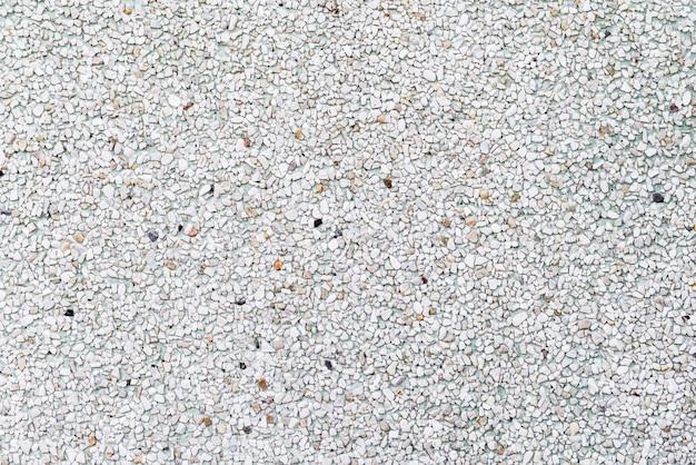 Textur von stangen oder boden, die durch kleine steine, steine gemacht