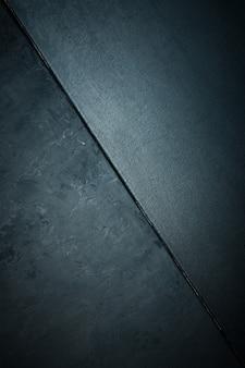 Textur von stein oder stein rau und textur leinwand schwarze farbe. legant mit vintage distressed grunge und dunkelgrauem hintergrund.