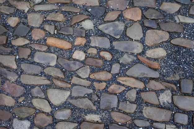 Textur von steinpflasterfliesen kopfsteinpflastersteinen hintergrund