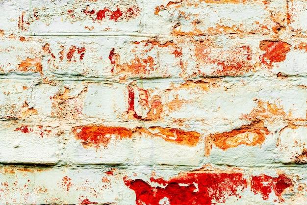 Textur, ziegel, wand, hintergrund. backsteinstruktur mit kratzern und rissen