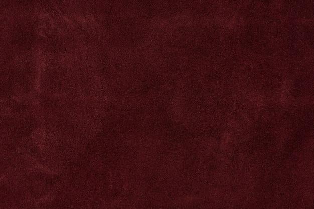 Texturhintergrund aus burgunderfarbenem lederwildleder