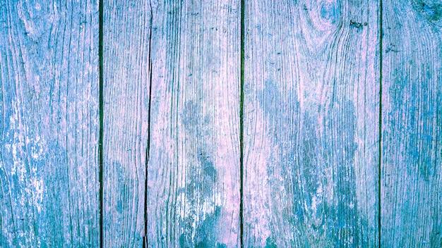 Texturhintergrund aus holz mit rosa und blauer gradinet-farbe