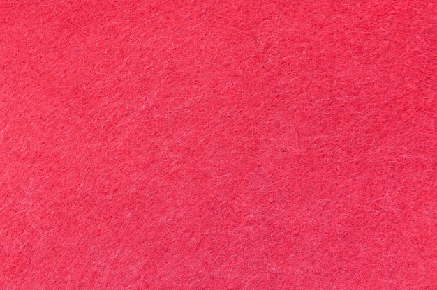 Texturhintergrund aus rotem samt oder flanell als hintergrund- oder tapetenmuster für die dekoration