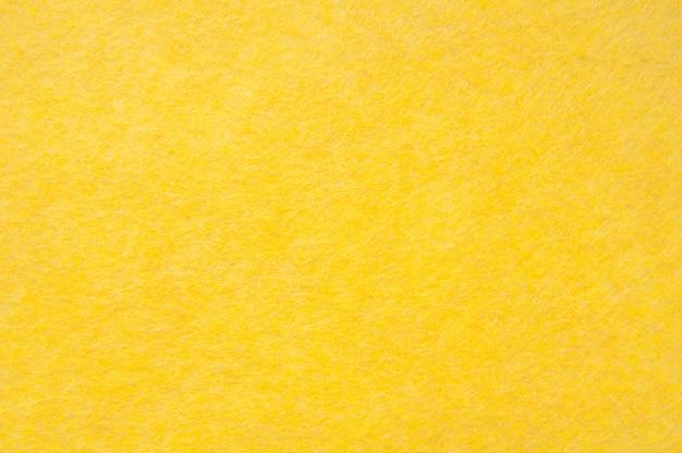 Texturhintergrund des gelben samts