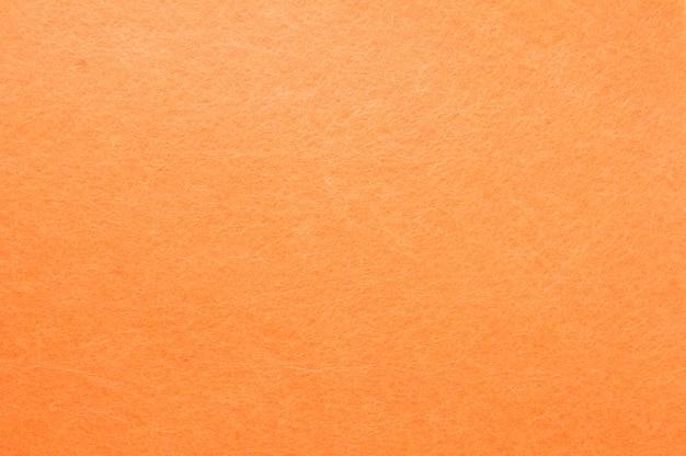 Texturhintergrund des orange samtes
