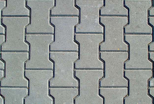 Texturhintergrund von betonpflaster oder bürgersteig mit pflastersteinen