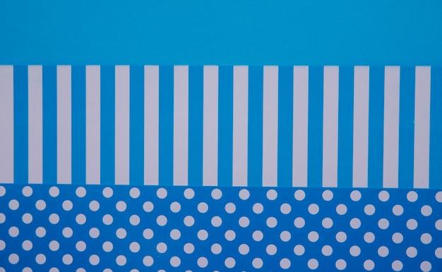 Texturhintergrund von modischen papieren im geometriestil. papier auf blauem grund. farbe hellen hintergrund.