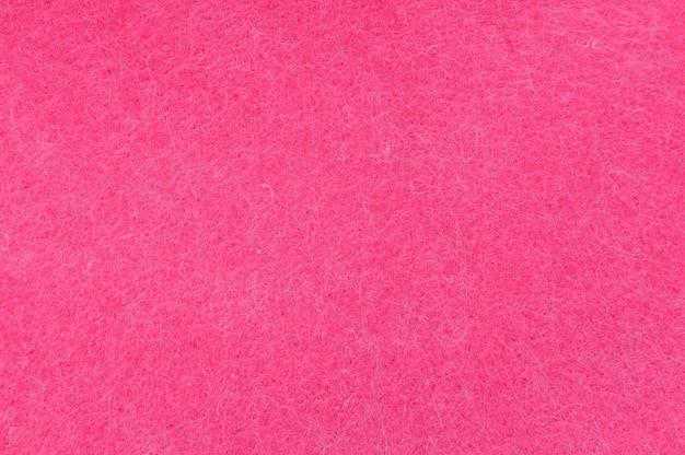 Texturhintergrund von rosa samt oder flanell als hintergrund- oder tapetenmuster für dekoration