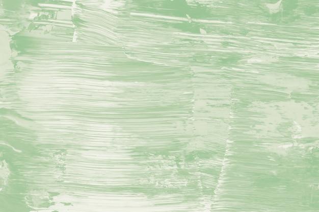 Texturierte farbhintergrundtapete in grüner acrylfarbe