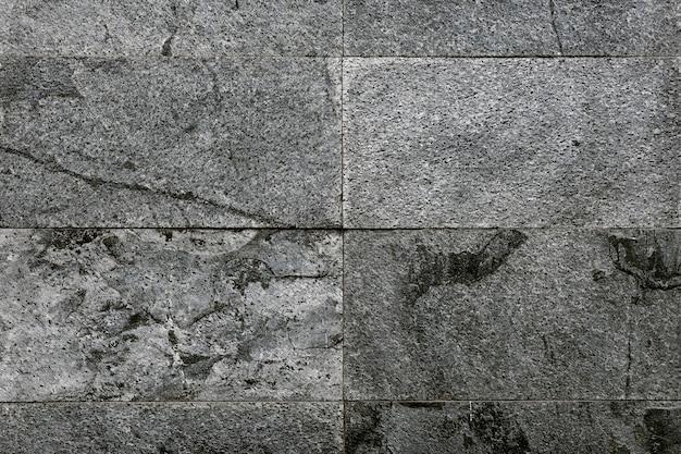 Texturierter hintergrund aus grauen marmorfliesen