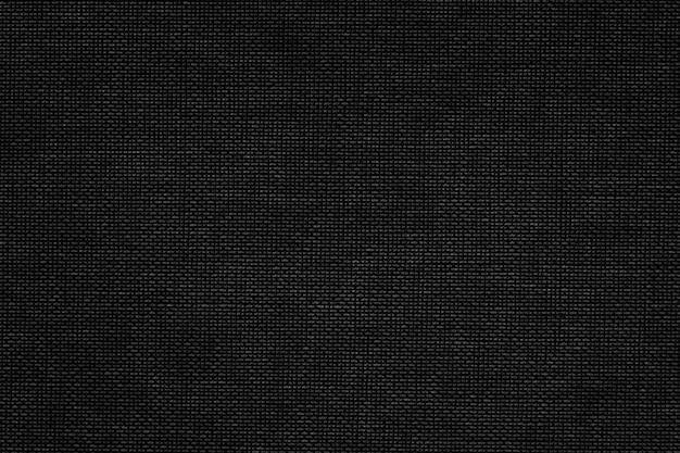 Texturierter hintergrund aus schwarzem stoff