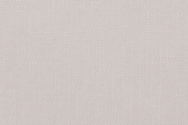 Texturierter textilhintergrund mit pastellbrauner prägung
