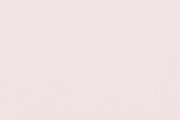 Texturierter textilhintergrund mit pastellrosaprägung