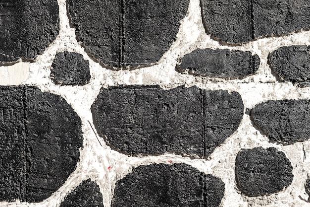 Texturiertes backgroung. verputzte weiße wand mit schwarzen flecken