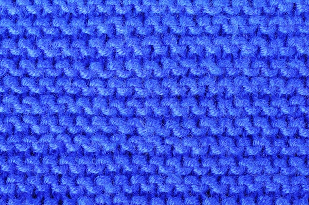 Texturmuster, strickmaterial aus blauen acrylfäden