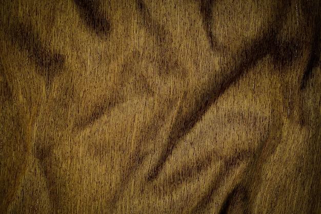 Thai seidentuch goldbraun hell glänzender seidenstoff strukturierter hintergrund