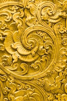 Thailändisches goldmuster handcraft traditionelle kultur-kunstdekoration im tempel