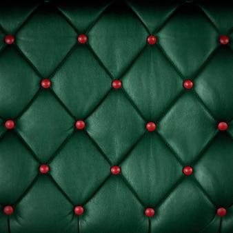 Tiefgrünes echtleder mit rotem knopf