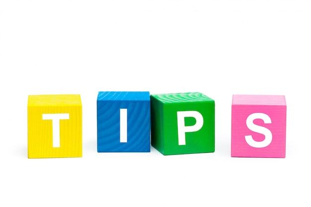 Tipp-konzept mit holzoberflächenblock