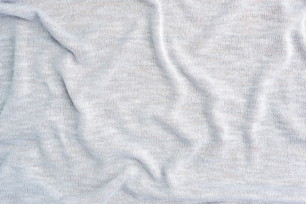 Tisch besteht aus grauem textilmaterial, der textur eines kleidungsstücks.
