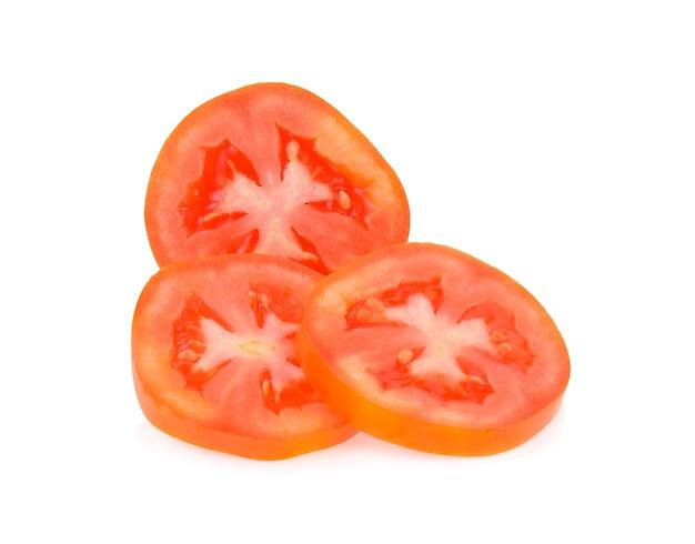 Tomatenscheibe isoliert auf weißem hintergrund Premium Fotos