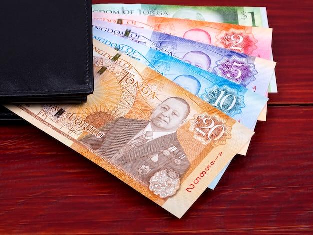 Tongaisches geld in der schwarzen geldbörse