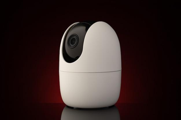 Tragbare überwachungskamera gegen dunkle oberfläche in neonlicht