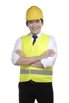 Tragende sicherheitsweste der asiatischen arbeitskraft und gelber sturzhelm