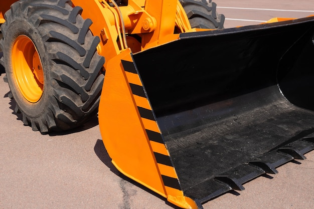 Traktorlader, gelber bagger, baumaschinen