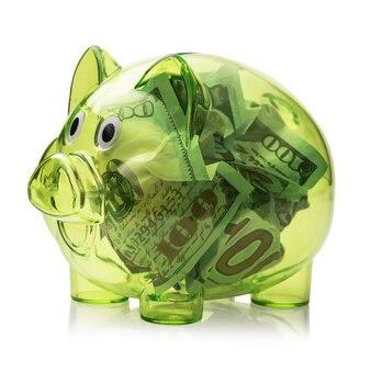 Transparentes sparschwein voller dollarnoten isoliert auf weißem hintergrund
