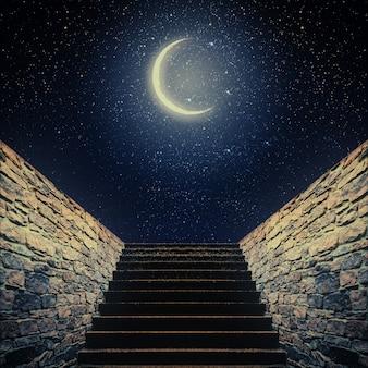 Treppe steigt zum mond in den nachthimmel. elemente dieses von der nasa bereitgestellten bildes