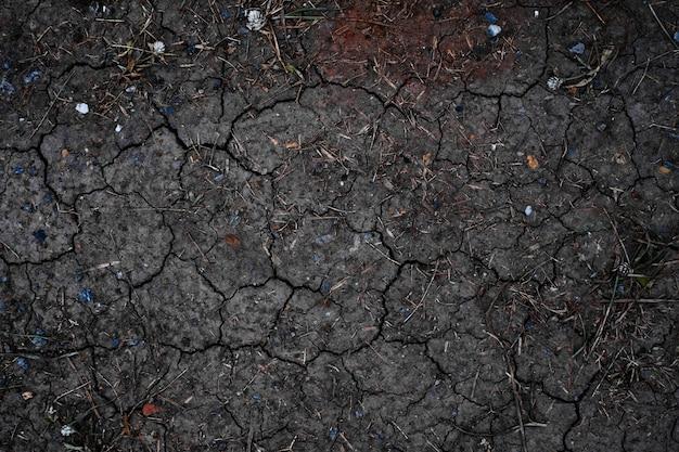 Trockenes land oder trockener boden. gebrochener hintergrund