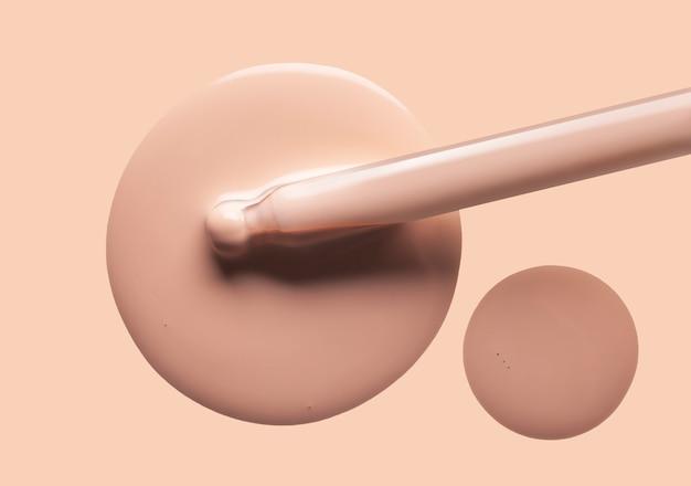 Tropfen flüssiger make-up-grundierung mit nackter farbe der pipettenstruktur