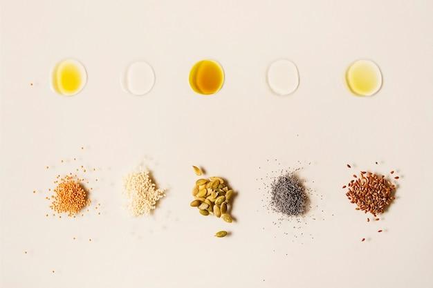 Tropfen verschiedener pflanzenöle für eine gesunde ernährung