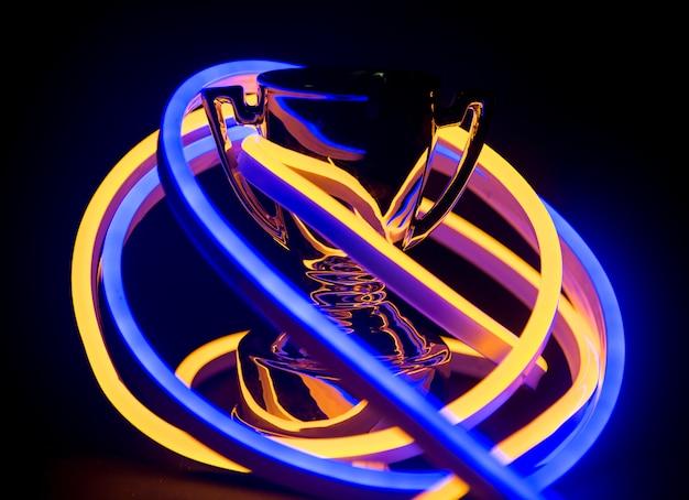 Trophäe in neonlichtern bedeckt