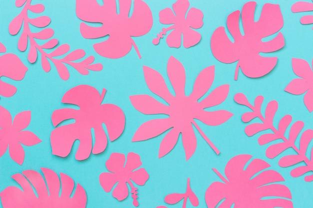 Tropische blätter muster. modische rosa tropische blätter des papiers, kreative papierkunst