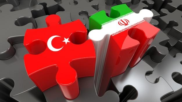 Türkei- und iran-flaggen auf puzzleteilen. politisches beziehungskonzept. 3d-rendering