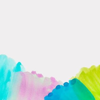Türkis; rosa; blauer und grüner aquarellpinselanschlag auf weißem hintergrund