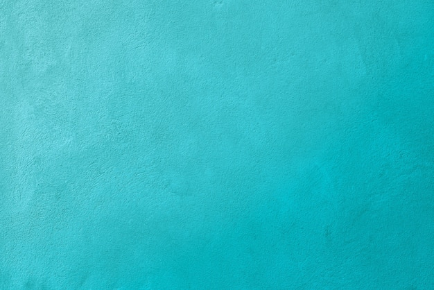 Türkisfarbene betonwandbeschaffenheitshintergrund mit fein rauer betonoberfläche. es ist kein rauschen oder filmkorn.