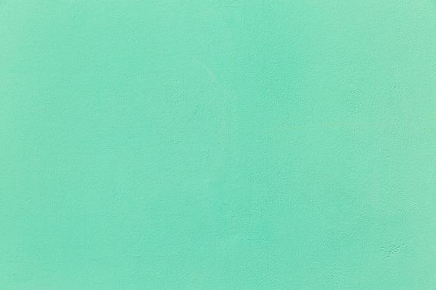 Türkisfarbene oberfläche von betonwänden. hintergrund. platz für text.