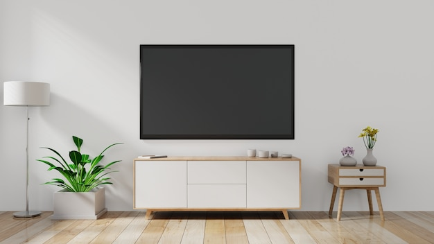 Tv an der wand und schrank, wohnzimmer.