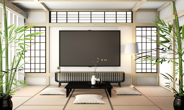 Tv-raum, smart-tv an der wand zen-raum sehr japanischer schweinestall und tatami-boden. 3d-rendering