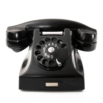 Überholtes telefon auf weißem hintergrund